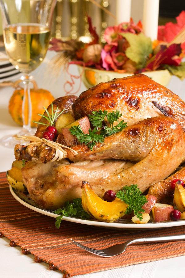 Roasted turkey. Feasting backed turkey on holiday table ready to eat stock images