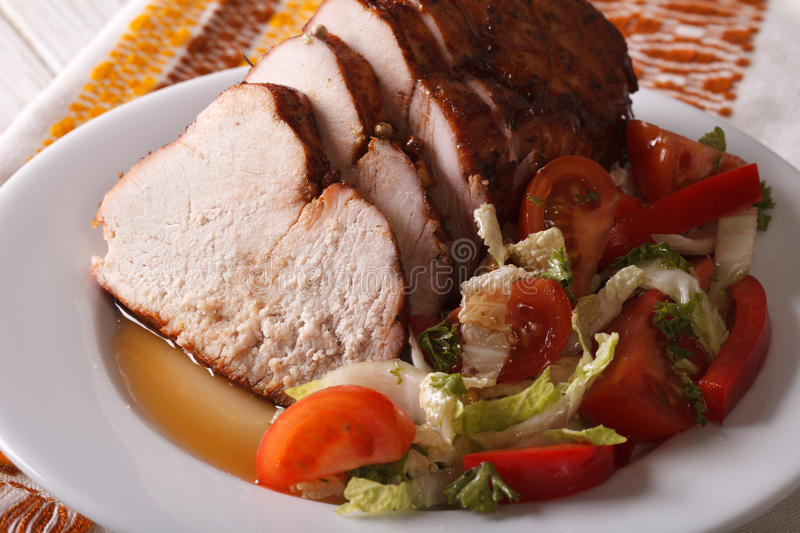 Roasted turkey breast and fresh vegetable salad closeup. Horizon stock photos