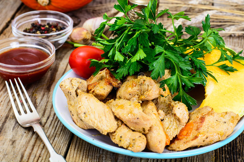 Roasted turkey breast with herbs, pumpkin soup and parsley on Th. Anksgiving Day on old boards royalty free stock images