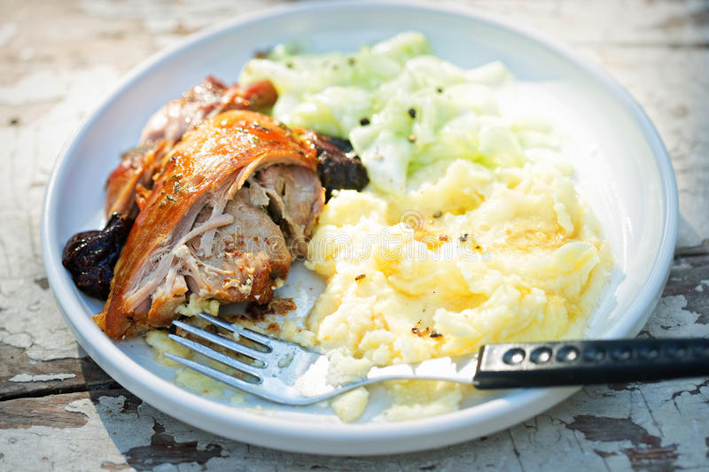 Roasted turkey breast with mashed potatoes and cucumber salad royalty free stock photo