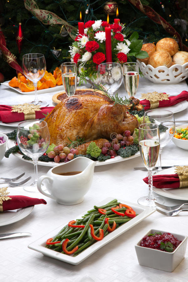 Roasted Turkey and Christmas Tree royalty free stock image