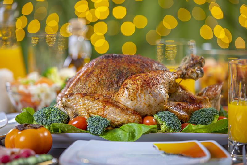 Roasted turkey on festive table for Thanksgiving celebration. Celebrating Thanksgiving with roasted turkey on festive table. Roasted turkey on festive table for royalty free stock images