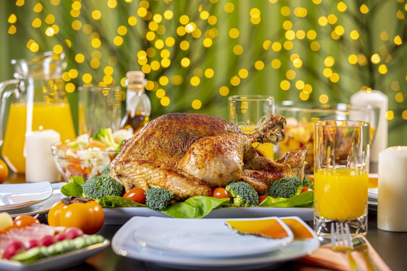 Roasted turkey on festive table for Thanksgiving celebration. Celebrating Thanksgiving with roasted turkey on festive table. Roasted turkey on festive table for stock image