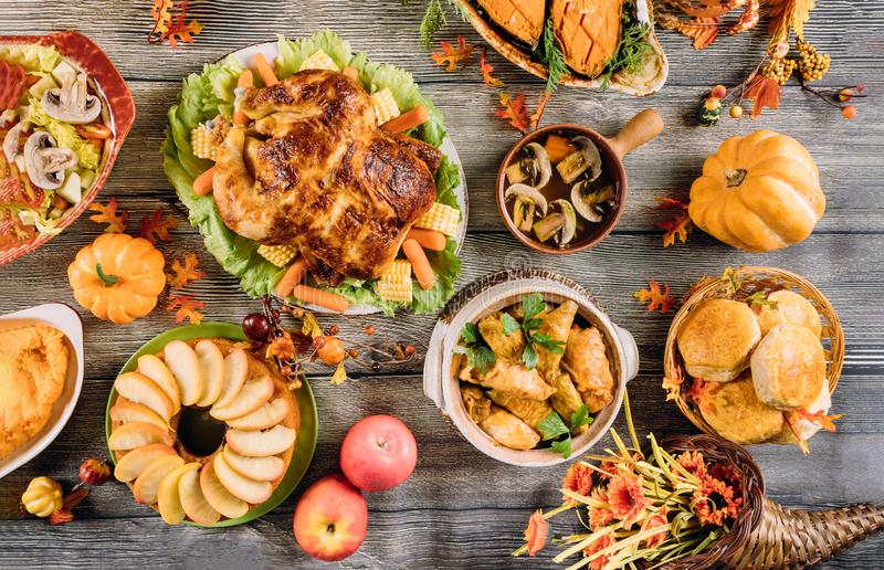 Roasted turkey garnished with many dishes on the table. Thanksgiving Day stock photos
