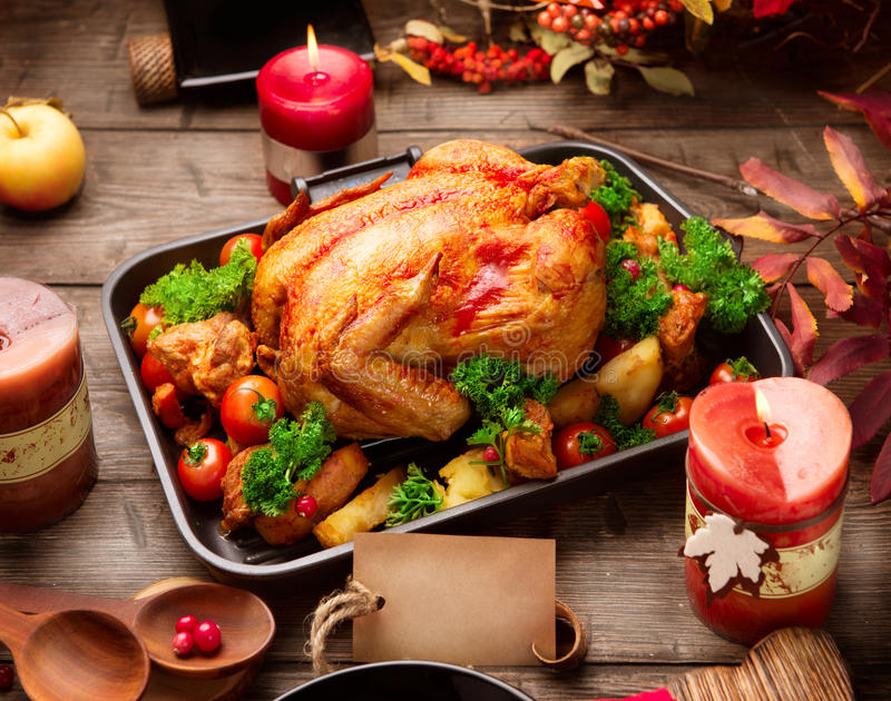 Roasted turkey garnished with potato. Thanksgiving or Christmas dinner. Roasted turkey garnished with potato, vegetables and cranberries. Thanksgiving or stock images