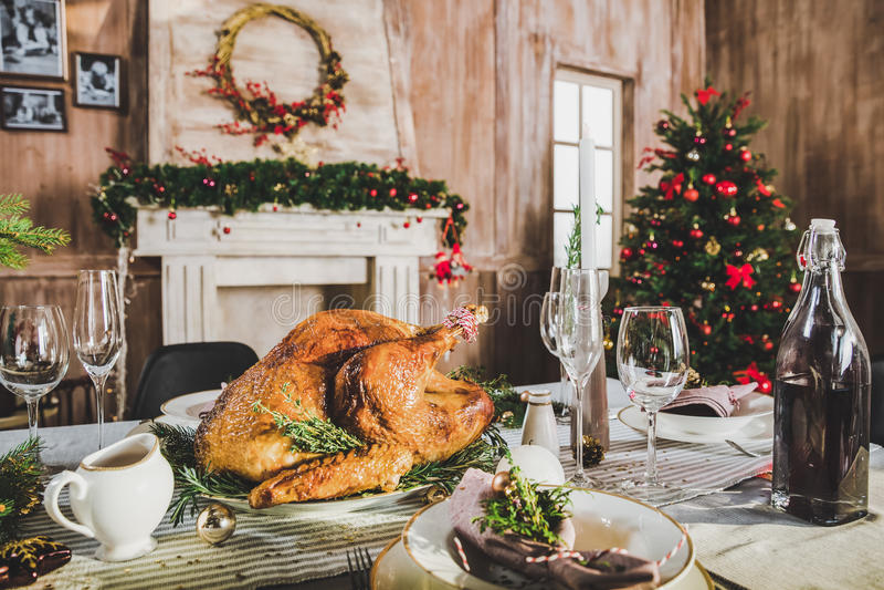 Roasted turkey on holiday table royalty free stock image