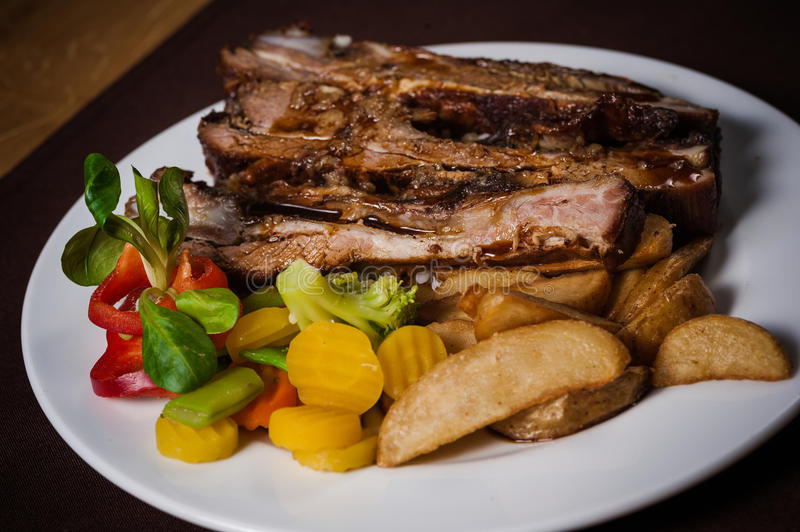 Roasted veal with potato stock image