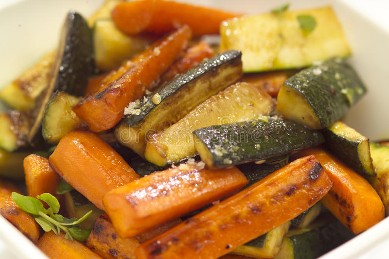Roasted vegetables. A bowl of roasted vegetables potato to share stock photography