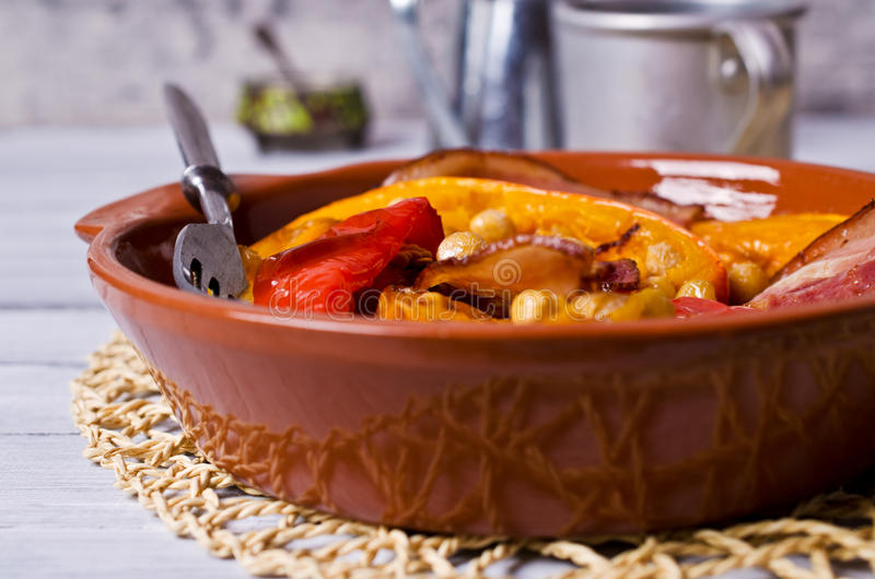 Roasted vegetables with bacon. And chickpeas. Selective focus stock images