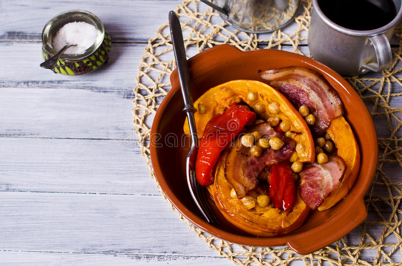 Roasted vegetables with bacon. And chickpeas. Selective focus royalty free stock photo