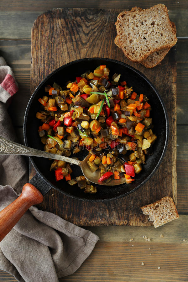 Roasted vegetables pieces, ratatouille in pan. Food close-up stock images