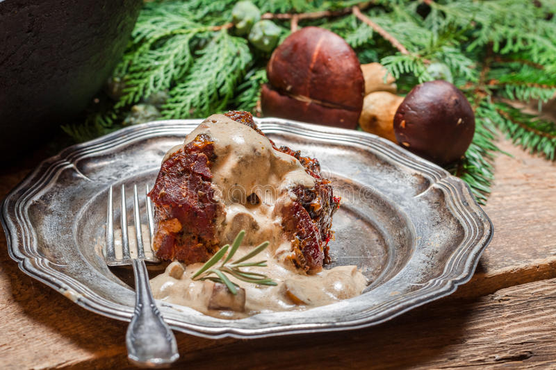Roasted venison served with mushroom sauce royalty free stock images