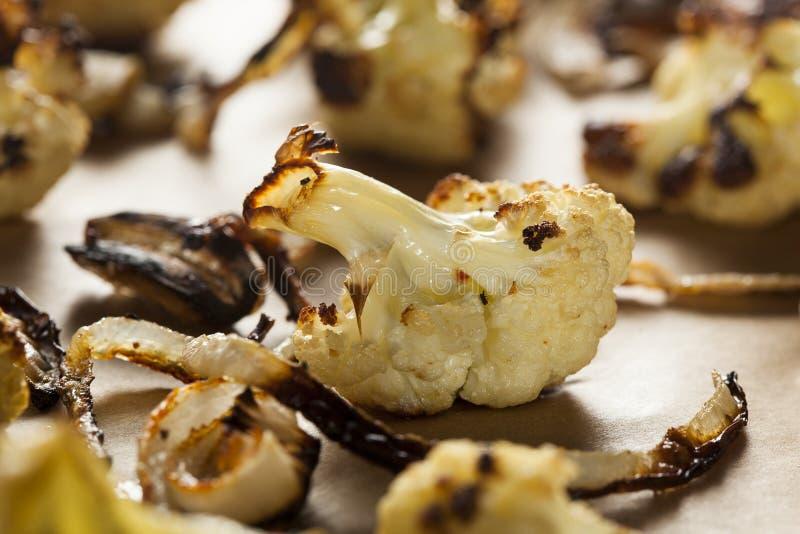 Roasted White Organic Cauliflower. With Onions and Garlic stock image