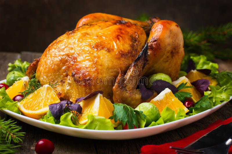Roasted whole chicken for Christmas royalty free stock photography