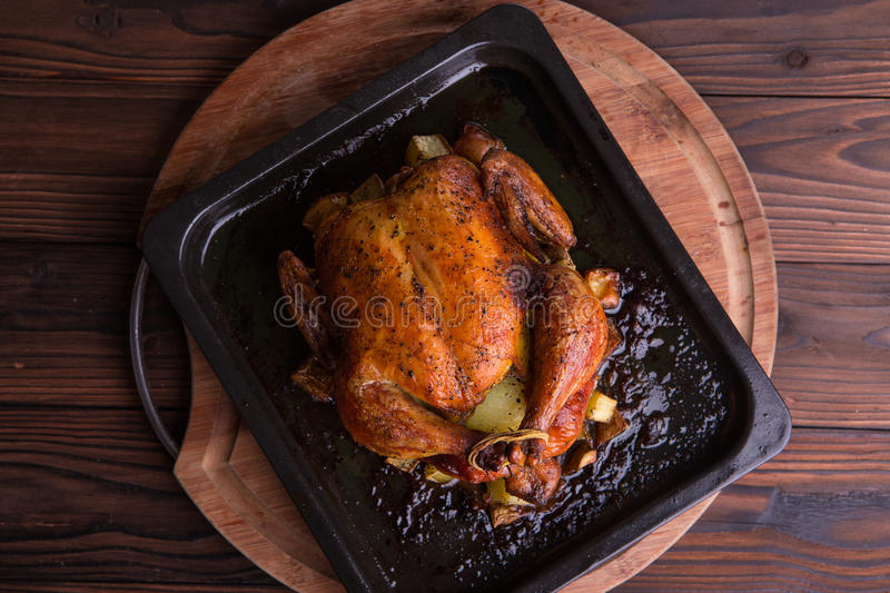 Roasted whole chicken / turkey for celebration and holiday. Christmas, thanksgiving, new year's eve dinner stock photo