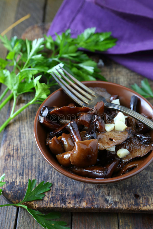 Roasted wild mushrooms with garlic stock photography