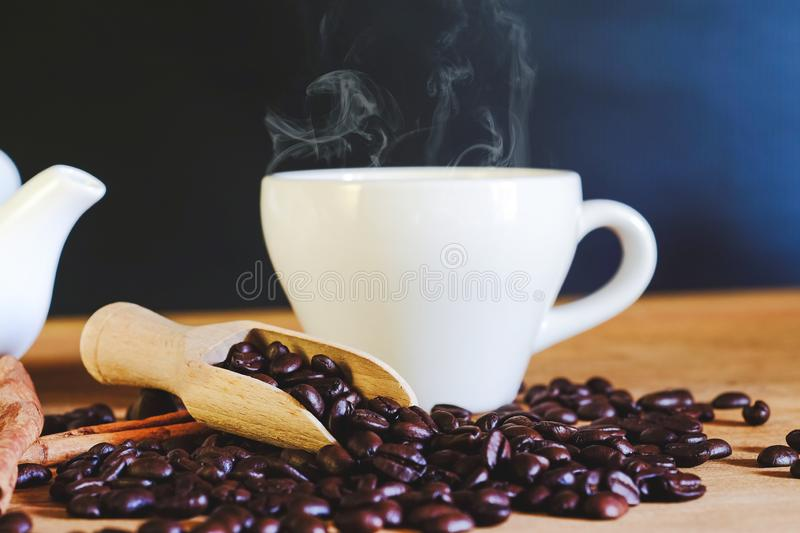 Roasters coffee bean in wood spoon. On table royalty free stock photo