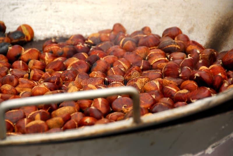 Roasting chestnuts stock photos