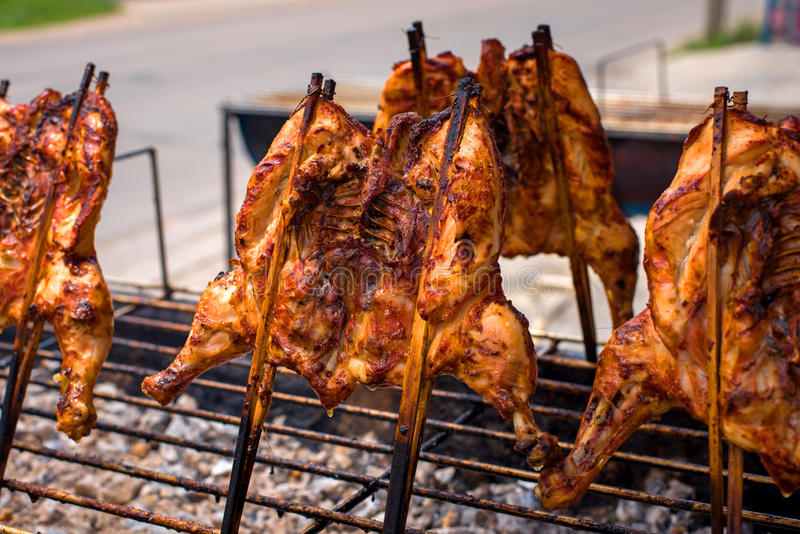 Roasting chicken, grilled chicken villager, thai local food. Hot roasting chicken, grilled chicken villager, thai local food stock images