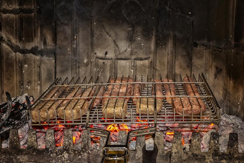 Roasting fresh meat in the fireplace. Make BBQ stock images