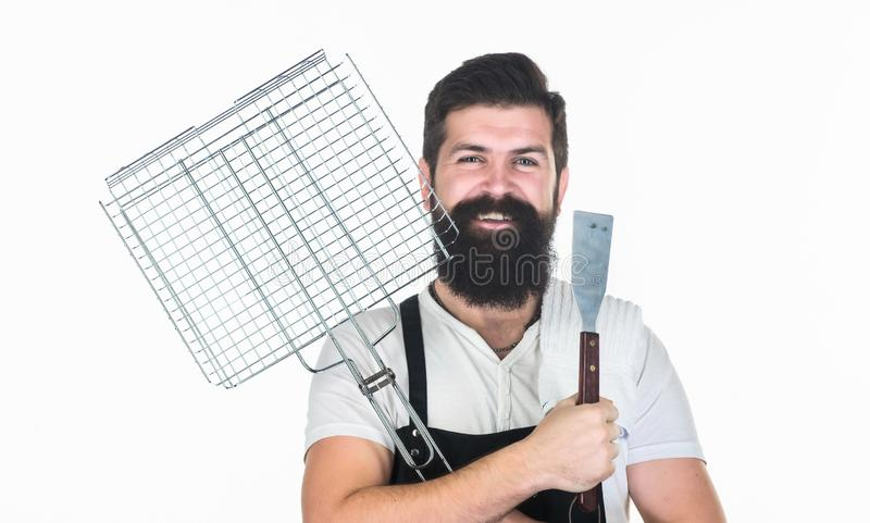 Roasting and grilling food. Bearded hipster wear apron for barbecue. Tips cooking meat. Tools for roasting meat outdoors royalty free stock photo
