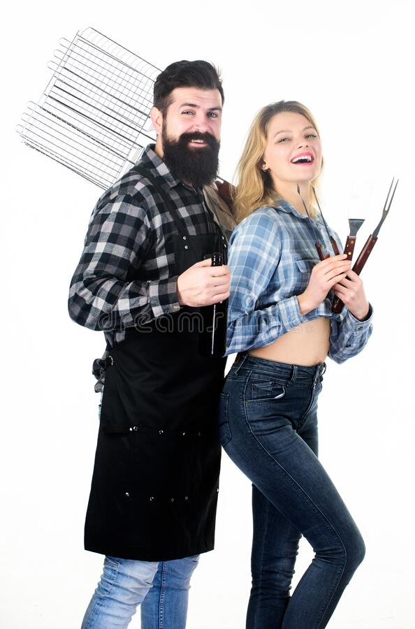 Roasting and grilling food. Cooking together. Couple in love hold cooking utensils barbecue. Tools for roasting meat. Outdoors. Picnic and barbecue. Bearded stock photo