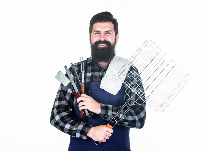 Roasting and grilling food. Man hold cooking utensils barbecue. Tools for roasting meat outdoors. Picnic and barbecue royalty free stock photography