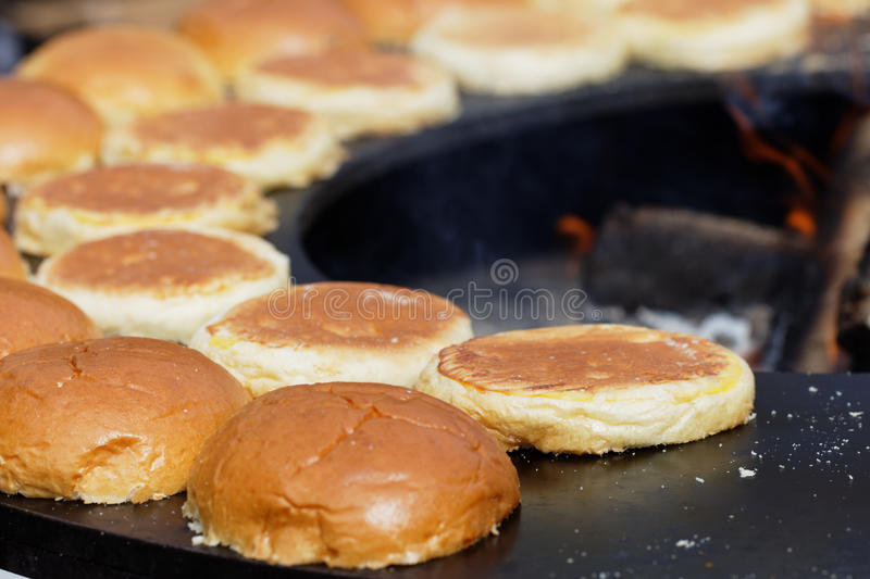Roasting hamburger buns for street food stock images