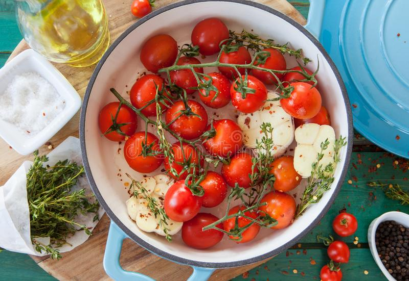 Roasting vine tomatoes in a pan stock photography