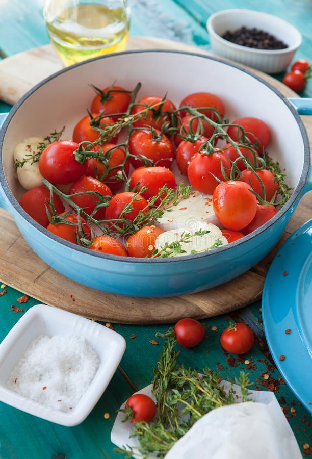 Roasting vine tomatoes in a pan royalty free stock images