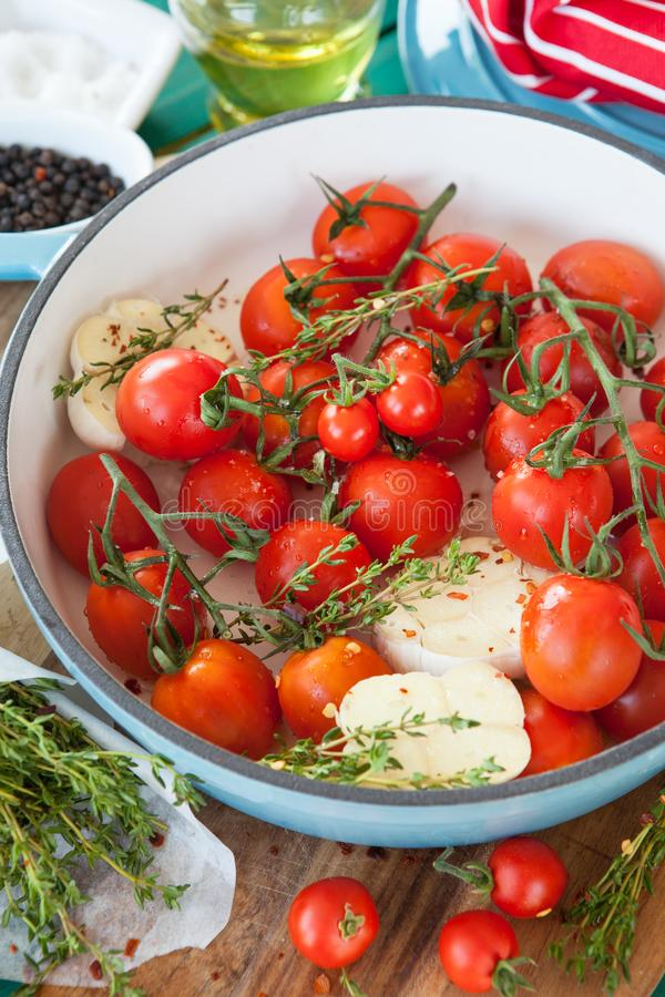 Roasting vine tomatoes in a pan stock image