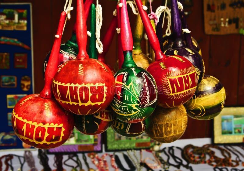 Roatan, Honduras Souvenirs. Colorful maracas, souvenirs from the island known as Roatan, Honduras, hang in a craft market in an area popular as a tourist stock images