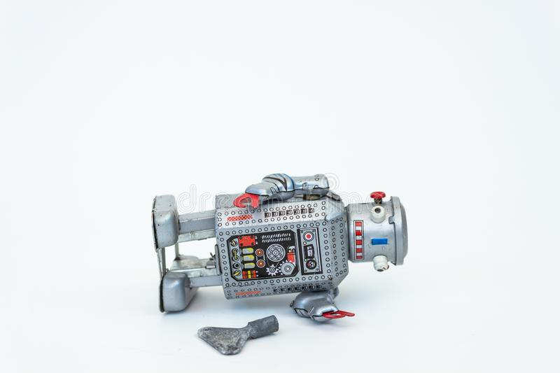 Robô com chave imagens de stock royalty free