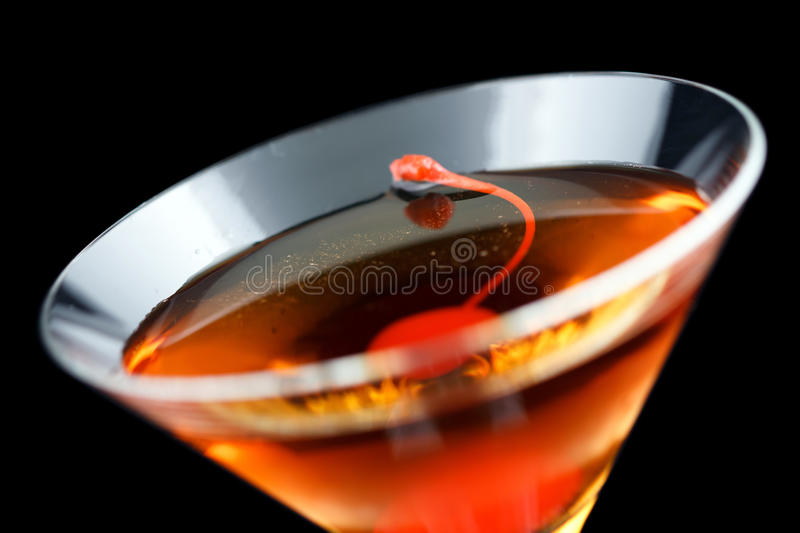 Rob Roy cocktail. Consisting of scotch, red vermouth and bitters and garnished with a maraschino cherry royalty free stock photography