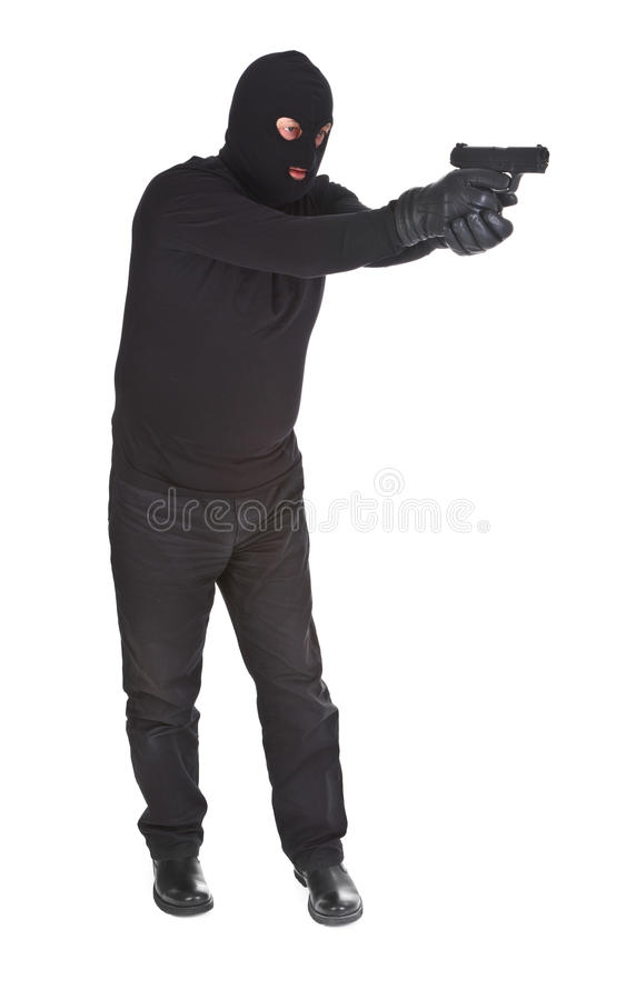 Robber aiming with his gun stock photo