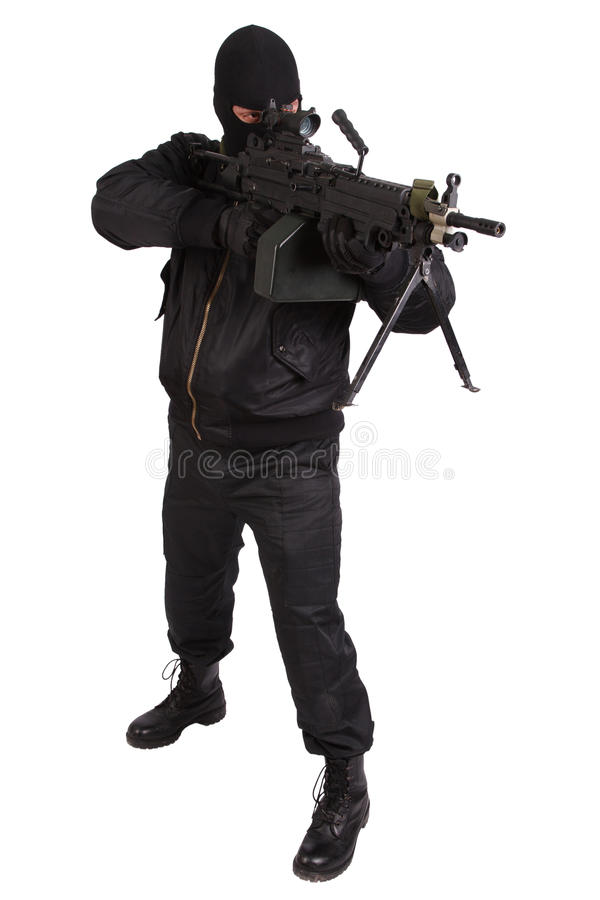 Robber in black uniform and mask with machine gun stock photos