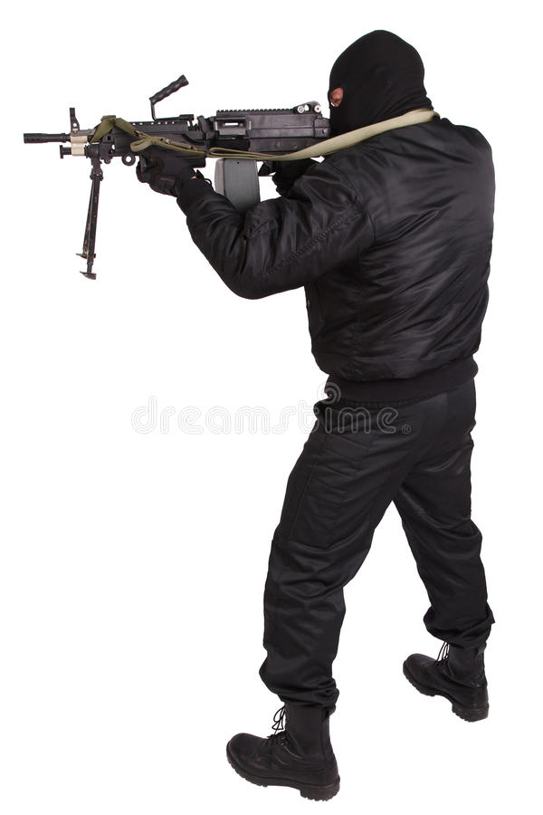 Robber in black uniform and mask with machine gun. Isolated on white stock photo
