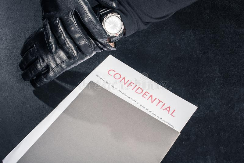Robber with confidential documents checking stock images