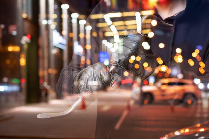 Robber with a crowbar . Robber with a crowbar on the background of night city stock image