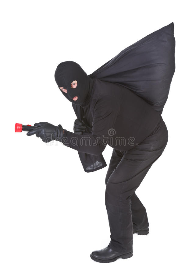 Download Robber With Flashlight And Sack Stock Photo - Image: 19924062