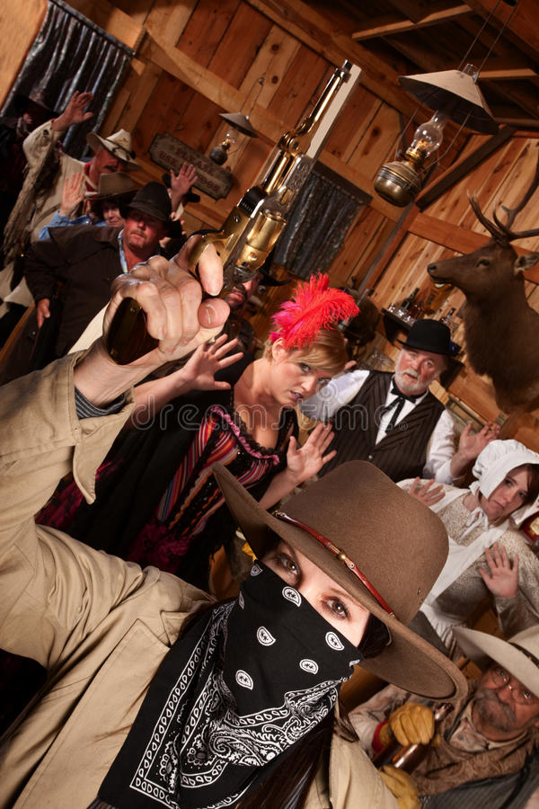 Download Robber Holds Up Customers In Saloon Stock Image - Image: 25011151
