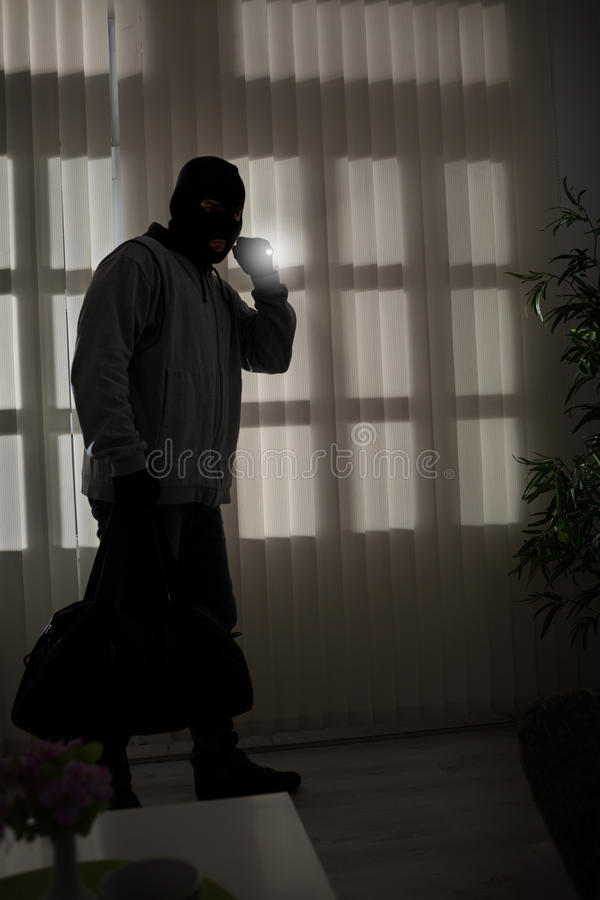 Robber in a mask. With flashlight royalty free stock images