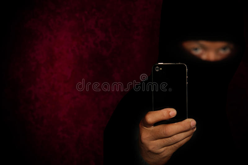 Robber with smartphone royalty free stock images