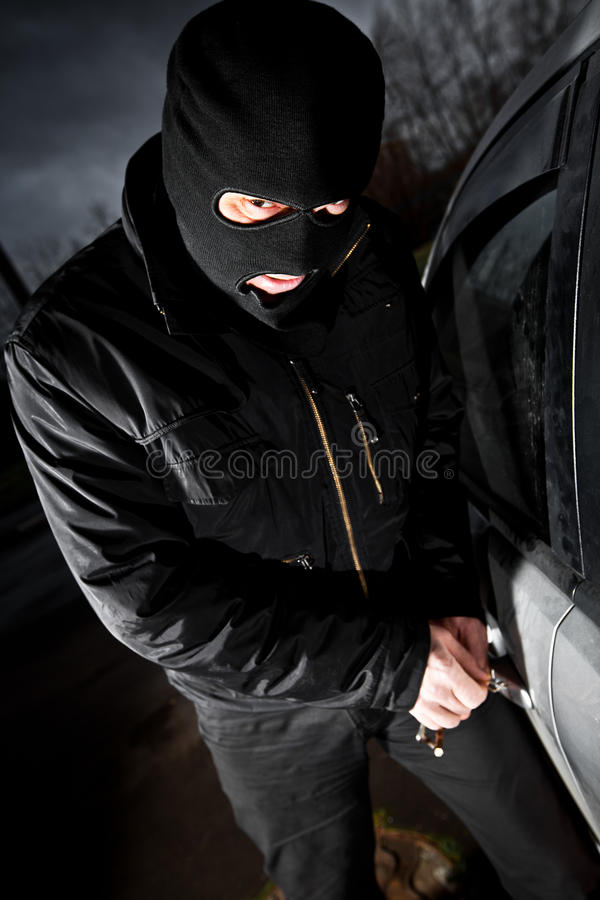 Download Robber And The Thief In A Mask Hijacks The Car Stock Photo - Image: 17855934