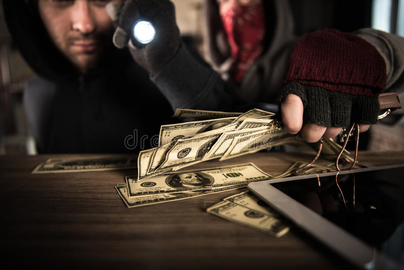 Robbers stealing money stock image. Image of stealing ...