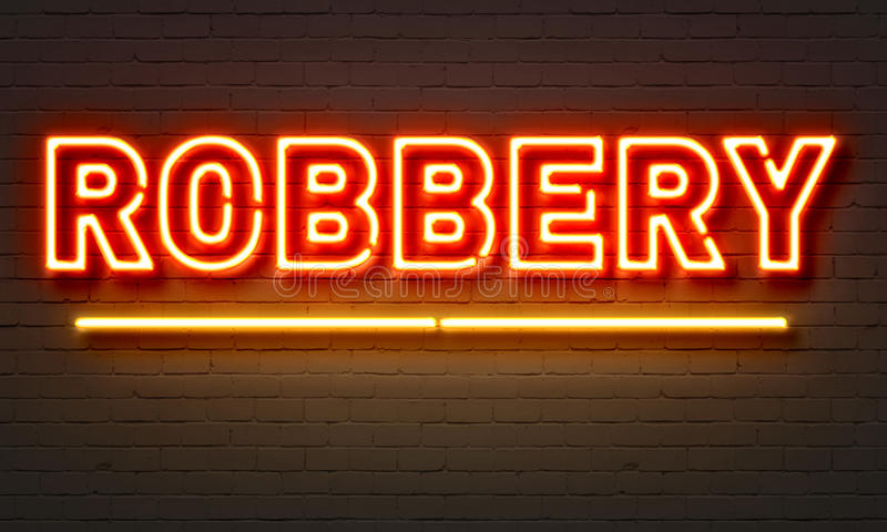 Robbery neon sign on brick wall background. royalty free stock photography