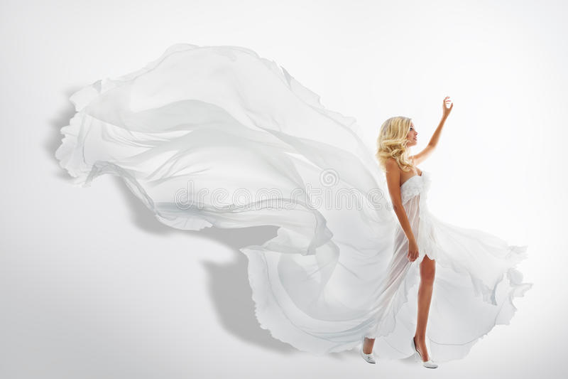 Robe de ondulation de blanc de femme, montrant la main, pilotant le tissu en soie photographie stock