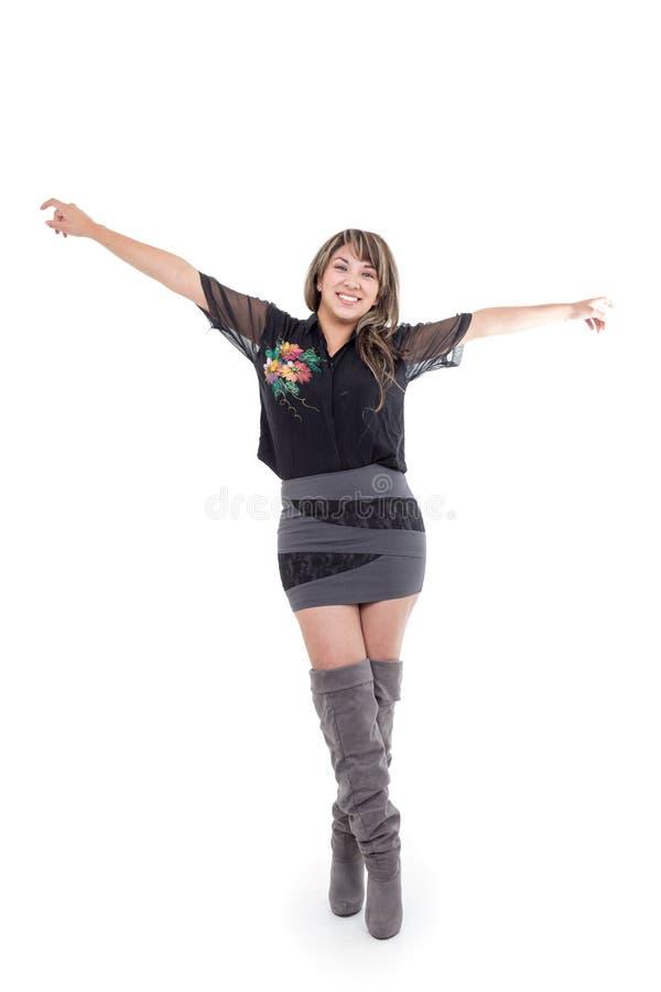 Robe de port et bottes de fille latine posant avec image libre de droits