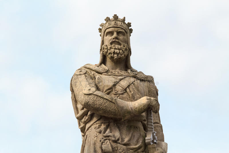 Robert the Bruce, King of Scots. Stone statue in front of Stirling castle. Scotland royalty free stock image