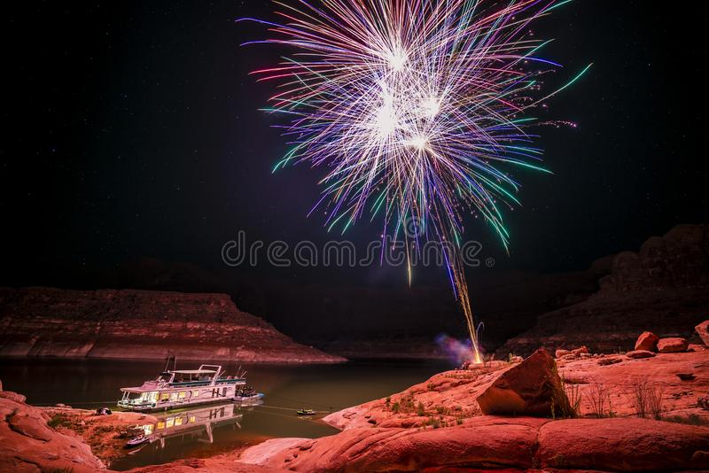 Fireworks over house boat. In the sandstone mountains of lake Powell area stock photos